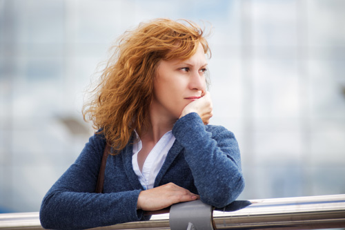 pensive woman looking out - what to expect - the aviary recovery center intensive outpatient program IOP near St Louis Missouri